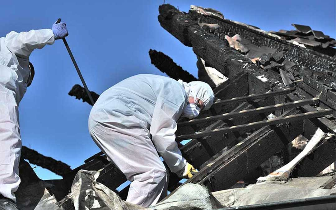Restoration experts cleaning up after fire damage