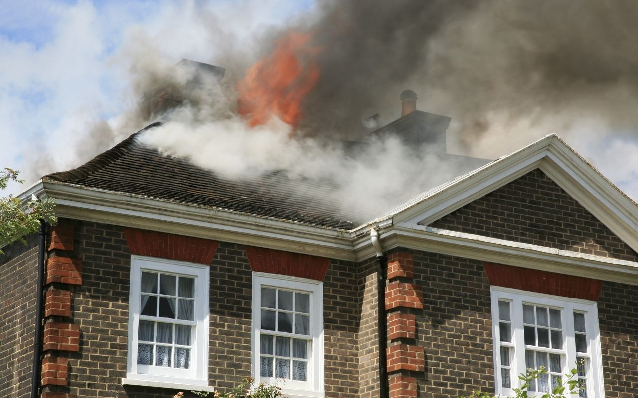 Fire coming through roof of a home